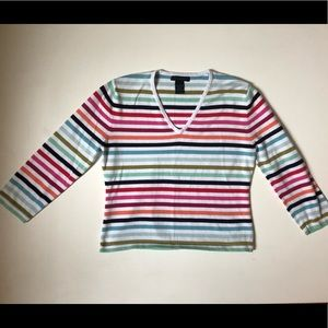 The limited rainbow stripe v neck sweater
